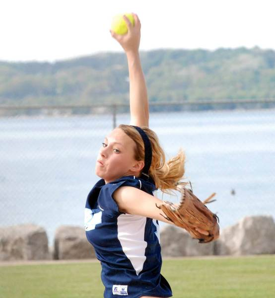 Petoskey pitcher Annie Hansen delivers to the plate Thursday during a Big North sweep of Traverse City West at Ed White Field. Hansen was the winning pitcher in both games, and homered in the nightcap.