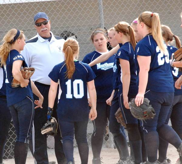 Petoskey softball coach Dave Serafini talks to his players between innings Thursday at Ed White Field. The Northmen will wear pink during their final home date of the season on Monday, May 21, to raise money for the American Cancer Society. The Northmen play host to Gaylord beginning at 4:30 p.m.