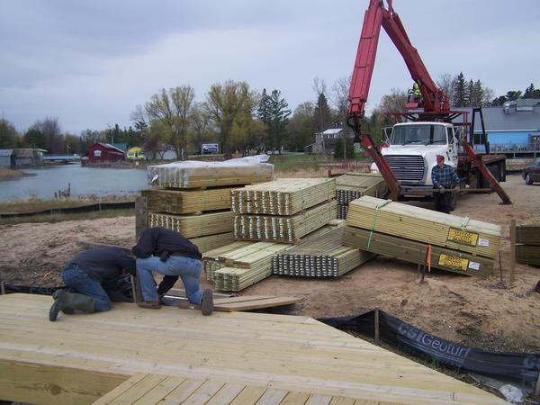 Volunteers work on the new Alanson boardwalk. When completed, the boardwalk will run from the bridge on M-68 to the village's swing bridge.