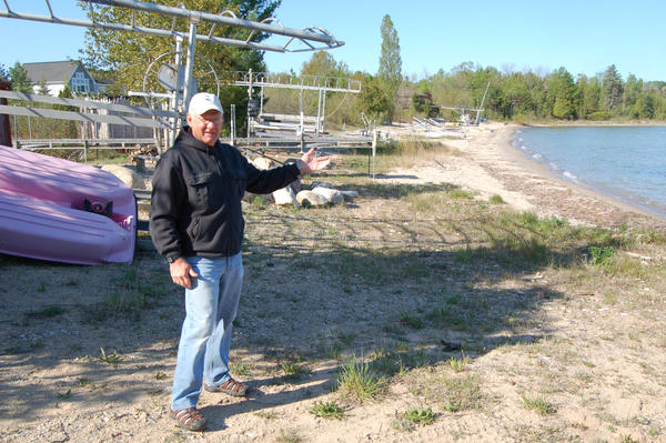 Jim Truchan stands where the waterline of Lake Charlevoix used to be, when he and his wife, Helen, bought the property in the early 1990s.