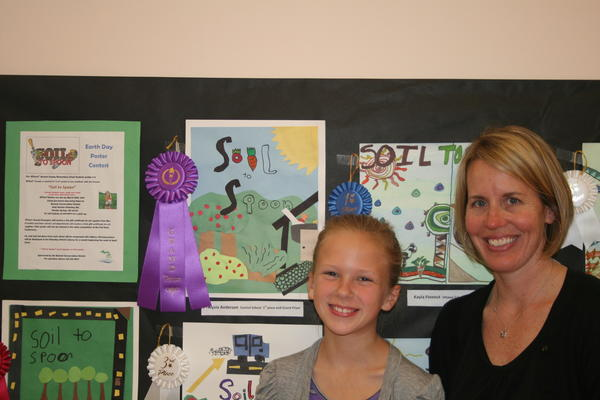 Alysia Anderson, a fourth-grader at Central Elementary School, is shown with her art teacher Jennifer Cleary. Alysia was the grand prize winner in the Emmet Conservation District Earth Day poster contest, and as a result she and her teacher were awarded gift certificates for art supplies.