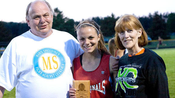 J-L senior Meridith DeLuca was the winner of the Ryan Shay 3,200-meter run at the Central Lake Class D meet Monday. Shay, from Central Lake, was an All-American and professional distance runner who died in 2007. Meridith is pictured with Shays parents, Joe and Susan.