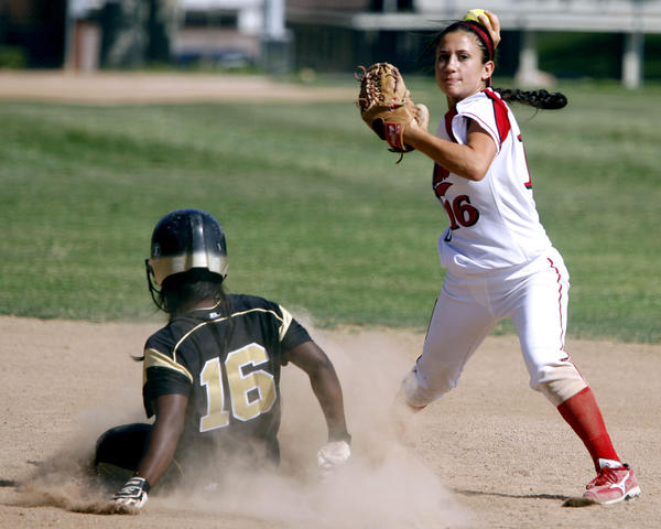 Burroughs High School's #16 Caitlin Loera gets the runner out at 2nd base before throwing to 1st base during CIF SS Div III softball first round playoff game at home vs. Knight High School in Burbank on Thursday, May 18, 2012.