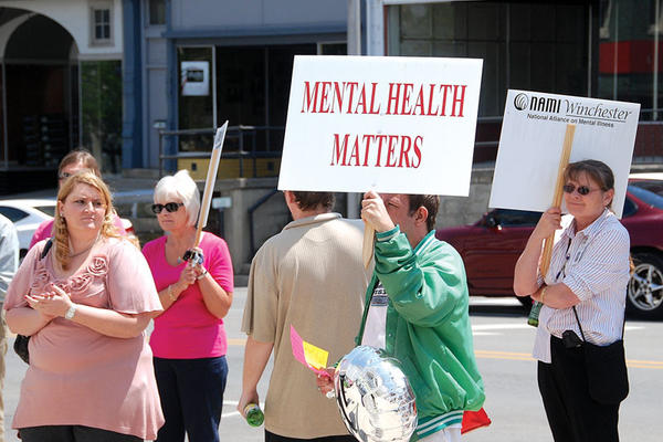 Several dozen people gather Thursday in front of the Clark County Courthouse to support the National Alliance on Mental Illness Mental Health Rally.