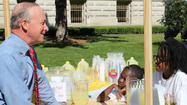 Indiana Gov. Mitch Daniels helped several young entrepreneurs sell lemonade at the Statehouse Friday afternoon in an effort to increase entrepreneurship.
