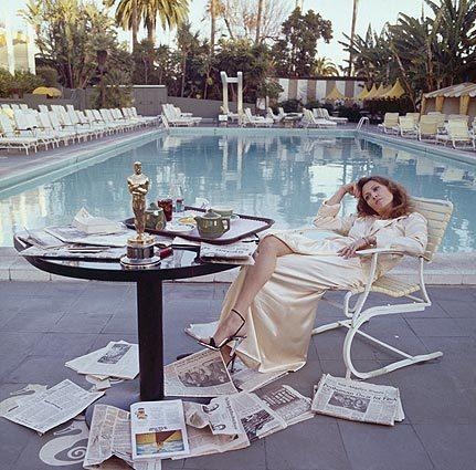 "Faye Dunaway takes breakfast by the pool with the day's newspapers March 29, 1977. She seems less than elated with her success at the previous night's Academy Awards ceremony, where she won the 1976 Oscar for actress in a leading role for ""Network."""