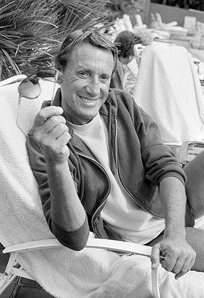 Actor Roy Scheider relaxes poolside in April 1983.