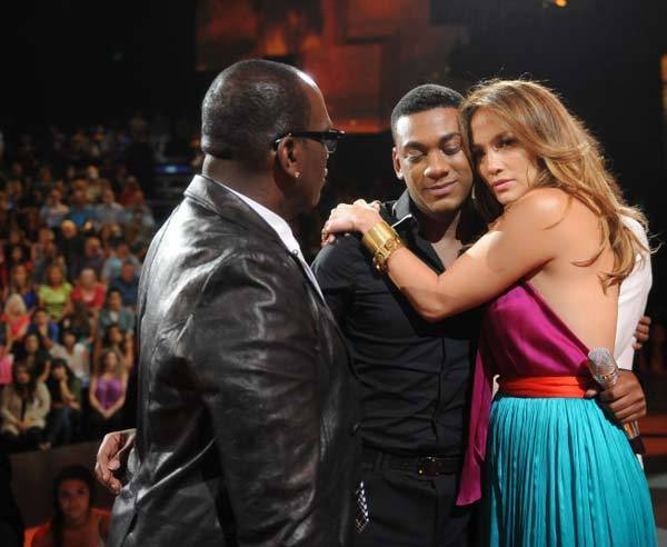 "Judges Jennifer Lopez and Randy Jackson comfort Josh Ledet after he is eliminated from ""American Idol."""