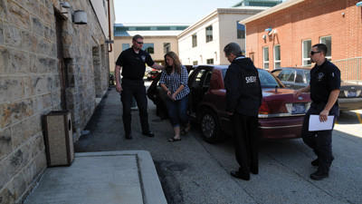 Sheriff's Deputy Dustin Weir escorts Samantha Jo Humbert into the Somerset County Jail Friday after a week-long hunt by the Sheriff's Office personnel. She was apprehension by the Paint Township police, who were helping the sheriff's office. Also shown are Sheriff John Mankey and Sheriff's Deputy John Loiodici, who is carrying the warrant.