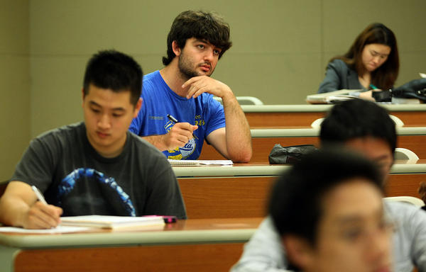 Philip Caltabiano listens to the instructor in a UCLA physics class. He studied marine biology and conservation biology and hopes to get a field research position after graduating next month. He has also applied to be a teaching assistant at UCLA.  He has $14,500 left in student debt; he has already paid back $7,000.