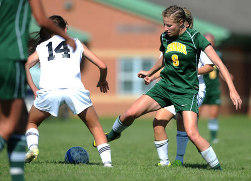 Emmaus' Sara Cressman (8) right, tries to steal the ball away from Northwestern's Sabrina Mertz (14) left, during their District 11 girls high school soccer soccer quarterfinal game Friday afternoon.