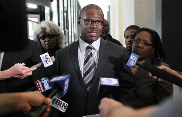 State Rep. Derrick Smith talks with media on April 30, 2012 after leaving court where he pleaded not guilty to federal bribery charges.