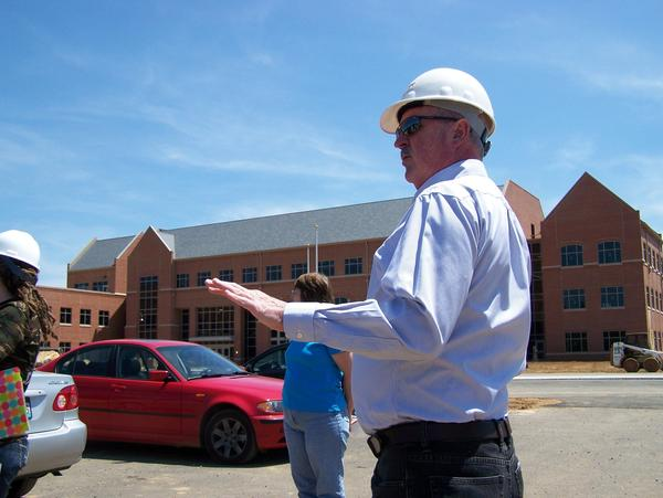 Blue Ridge Community and Technical College President Peter G. Checkovich gives faculty and staff a tour of the school's new campus building Friday. School administrators are projected to begin moving to the campus off W.Va. 45 in July and be ready for the beginning of fall semester classes Aug. 20.