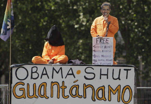 In this May 25, 2011 photo, protesters demonstrate outside Britain's Houses of Parliament in central London, where President Obama was to give an address. On Wednesday, a federal judge ruled that provisions of a defense authorization act signed by Obama are unconstitutional because they could subject activists to military detention.