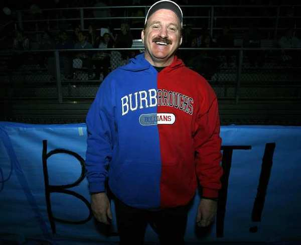 Burbank Unified School District Supt. Stan Carrizosa didn't pick sides and showed his support for both teams in a Pacific League football game at Arcadia High School. Carrizosa is leaving the district to become president of College of the Sequoias.