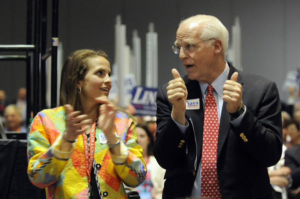 U.S. Senate candidate Chris Shays applauds with his daughter, Jeramy, at the state Republican convention at the Connecticut Convention Center Friday night.