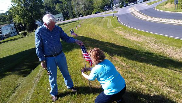Jim Stull and his daughter, Diana Stull, placed about 30 small American flags and poles in the grass along the U.S. 15 north on-ramp on Friday morning.