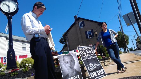 Ben Deniston (left) and Asuka Saito of Virginia set up a table in Thurmont's downtown square on Friday on behalf of the Larouche Political Action Committee, urging that President Barack Obama be removed from office.
