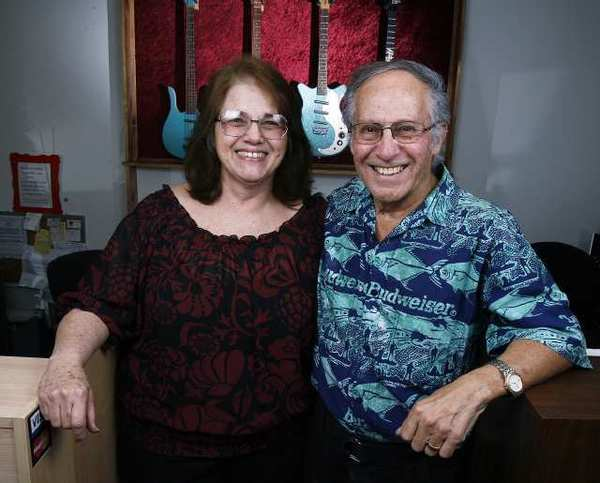 Diane and Manny Mora, co-owners with their son Joe of newly remodeled Pedrini Music in La Crescenta.