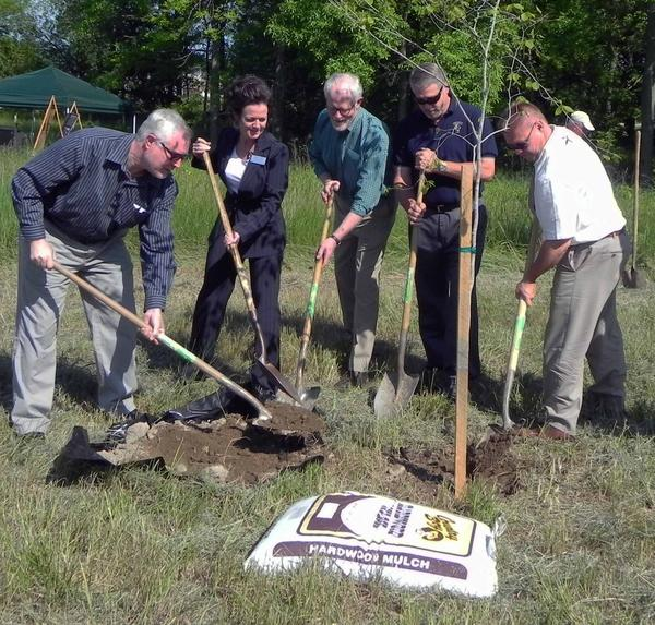 "From the left, Franklin County Commissioner Robert ""Bob"" Thomas, Nancy Bull of U.S. Rep. Bill Shuster's office, AWA Board President Stephen Rettig, Washington Township Board of Supervisors Chairman Jeffrey Geesaman and Sen. Rich Alloway II, R-Chambersburg plant one of three beech trees at Antietam Meadow Park."
