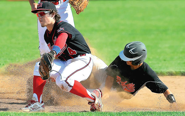 North Hagerstown's Charles Cvijanovich (4) fields a throw as Rockville's Brady Petrie slides in safely at second base in the fourth inning of Friday's Maryland Class 3A West baseball final at North.