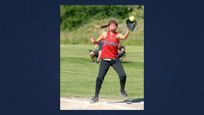 First baseman Megan Gnagey takes a throw to put out an Everett runner in Meyersdale's last home game of the season.