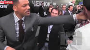 "Will Smith is probably wishing for a real-life mind eraser after a reporter tried to kiss him Friday at the ""Men in Black III"" premiere in Moscow."