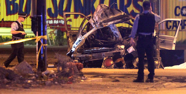 Chicago police work at the scene of a multiple fatality car accident at the corner of 31st and Kedzie in Chicago.