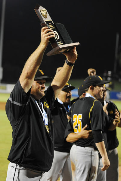 American Heritage head coach Bruce Aven holds up the 5A state baseball trophy s after defeating Ponte Vedra High 9-0. 5/18/12. Jim Rassol, Sun Sentinel.