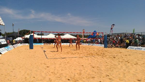Players take to the volleyball court at the 2012 Preakness.