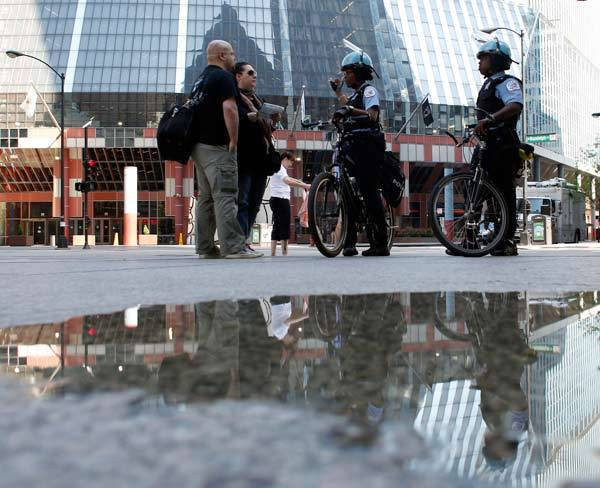 Police officers give directions as they patrol the streets near Daley Plaza in preparation for demonstrators ahead of the NATO meeting in Chicago.