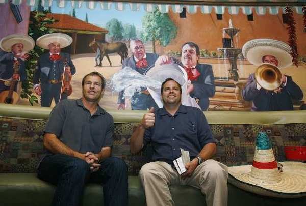 Happy with the work, artist Evan Wilson and restaurant owner Bent Hansen smile for family and friends who were at Los Gringos Locos restaurant in La Canada Flintridge for the unveiling of the mural by Evan Wilson.