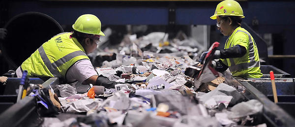 Sorters remove recyclables Thursday at Waste Management recycling facility near Elkridge, Md.