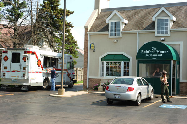 State police and local police investigate the scene at the Ashford House Restaurant at 7959 W. 159th street in Tinley Park.