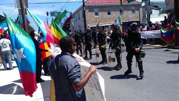 Police and protesters in Thurmont's town square on Saturday, the closing day of the G-8 Summit in nearby Camp David.
