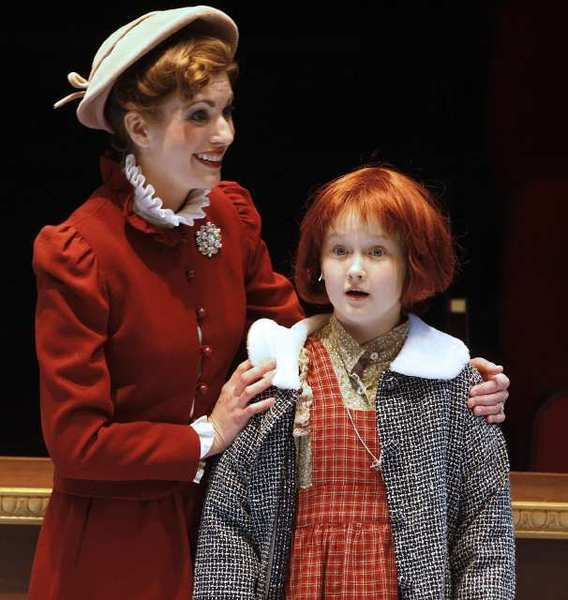 Heather Dudenbostel, as Grace, shows Annie, played by Emma Howard, her new home at a final dress rehearsal of 'Annie' at the Glendale Centre Theatre.