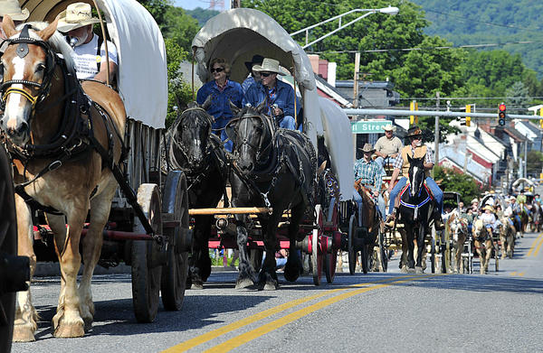The 24th annual Wagon Train, part of the National Pike Festival, travels through downtown Clear Spring Saturday morning heading toward Hagerstown.