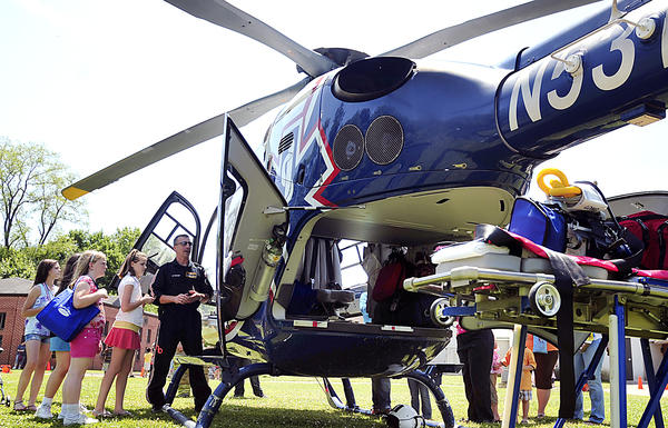 Kids of all ages take a tour of the Air Methods Life Net 8-1 helicopter after watching it land at Children's Village of Washington County, Saturday during Kids Alive Fest in Hagerstown.
