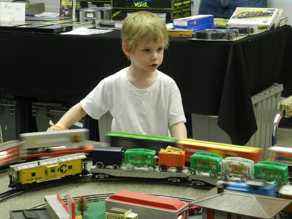Braddock Wright, 4, of Falling Waters, W.Va., controls a three-rail Lionel O gauge train at Railroad Heritage Days Saturday at the Hagerstown Roundhouse Museum.
