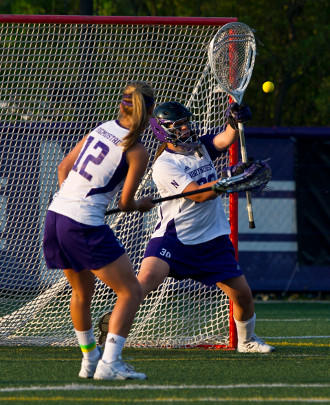 Brianne LoManto making one of her eight saves Saturday night against Duke.