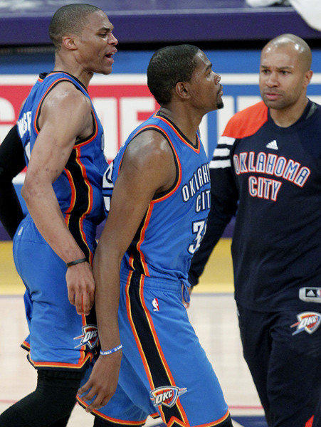 Kevin Durant, center, is congratulated by Russell Westbrook, left, and Derek Fisher after hitting a three-pointer that wound up being the game-winner.