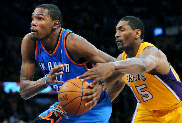Kevin Durant drives past Metta World Peace during the second half of Game 4.