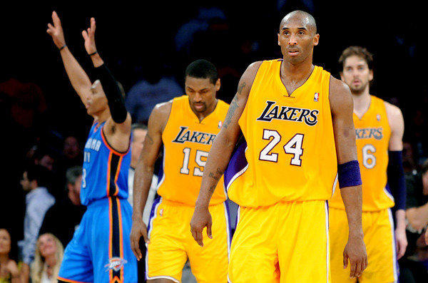 Kobe Bryant, Metta World Peace and Pau Gasol walk off the court after the Lakers 103-100 Game 4 loss to the Thunder.