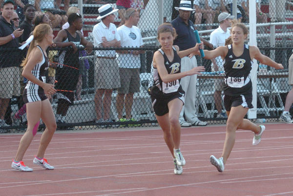 Boyle County's Tabitha Evans, left, takes the baton from Natalie Settle for the second leg of the Class AA 1,600-meter relay. Boyle ran a faster time than when it won the 1,600 relay last season, and finished third in a school-record time of 4 minutes, 6.31 seconds. Boyle finished fourth in the state as a team, and Evans also placed sixth in the triple jump.