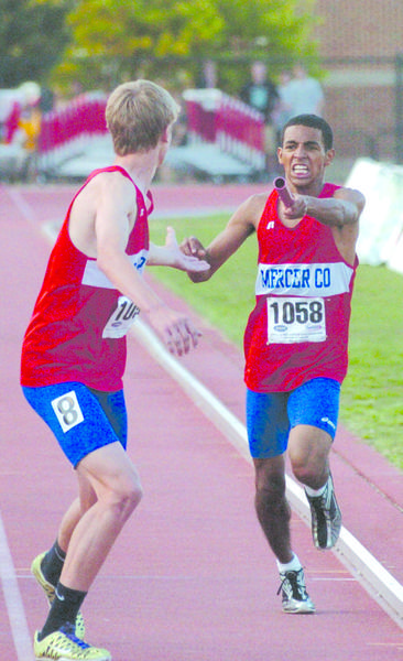 Mercer County's Landon Souder, in front, takes the baton from Jawan Smith for the final leg of the Class AA 1,600-meter relay Friday. Mercer finished second in the race. Souder also anchored the winning 3,200 relay team as the Titans placed sixth in the state as a team.