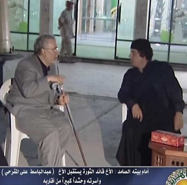 "In this image  taken from a newscast on <a class=""taxInlineTagLink"" id=""PLGEO00000082"" title=""Libya"" href=""/topic/intl/libya-PLGEO00000082.topic"">Libya's</a> official television, Libyan leader Moammar Kadafi   meets with freed Lockerbie bomber <a class=""taxInlineTagLink"" id=""PEOCVC000005"" title=""Abdel Baset al-Megrahi"" href=""/topic/crime-law-justice/crimes/criminals/abdel-baset-al-megrahi-PEOCVC000005.topic"">Abdel Basset Ali Megrahi</a>  in Tripoli."