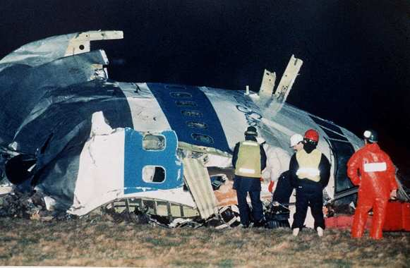 Rescue workers examine the nose of Pan Am flight 103 near the town of Lockerbie, Scotland,after a bomb aboard exploded and killed 270 people.