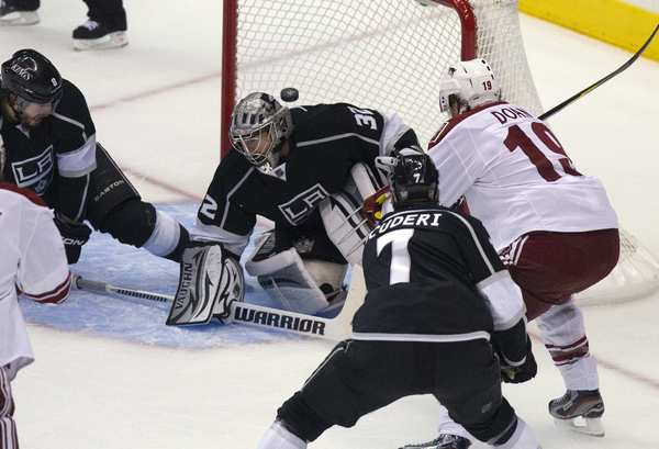 Coyotes captain Shane Doan scores a shot over the head of Kings goaltender Jonathan Quick in the first period of Game 4 on Sunday at Staples Center.