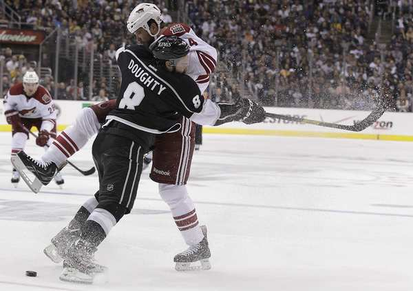 Kings defenseman Drew Doughty checks Coyotes winger Taylor Pyatt during the second period of Game 4 at Staples Center on Sunday.