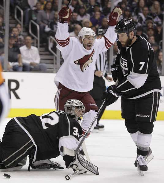 Coyotes center Antoine Vermette reacts as the puck rebounds out of the net past Kings goaltender Jonathan Quick for a goal by Shane Doan in the second period of Game 4 on Sunday afternoon.